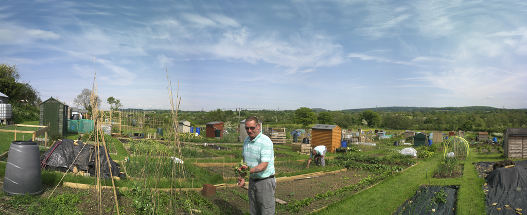 Photo of a man standing in a Frome allotment