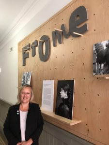 Photo of Camille Claudel in front of exhibition photographs at Frome Town Hall.