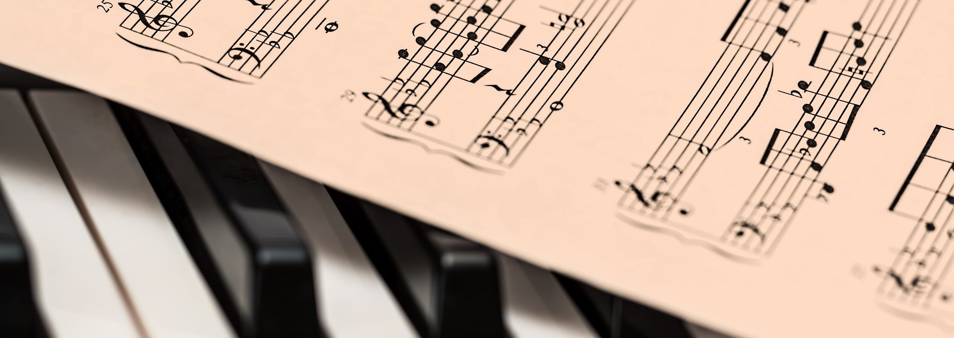 music on top of piano keys