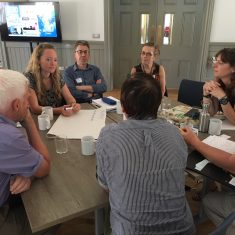 people sitting round table at meeting