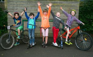 Image of young people using scooters and bikes as part of the School Travel Challenge