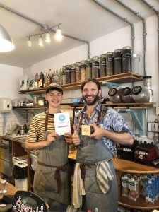 Staff at River House holding their Plastic Free Champion award