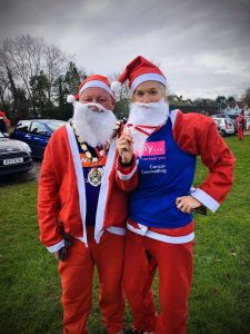 Mayor of Frome, Mark Dorrington, with Sergeant Rachel Clark, at the Frome Santa Dash in December 2019