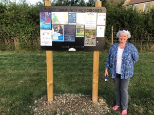 Volunteer at Frome Town Council noticeboard