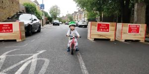 image of child cycling on a School Street