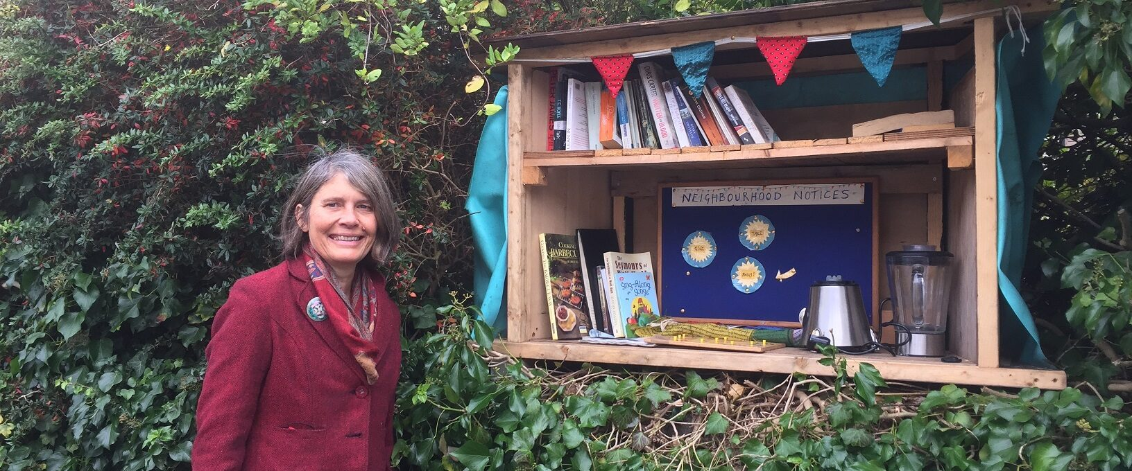 Photo of lady next to the Nunney Road share box