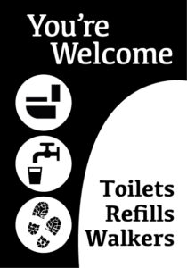 'You're welcome' sign with 'Toilets, refills, walkers'
