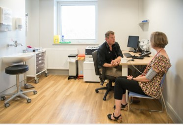 Picture of a patient with a Doctor in a consulting room
