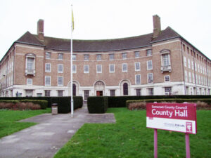 County Hall in Taunton, with a sign and lawn in  front