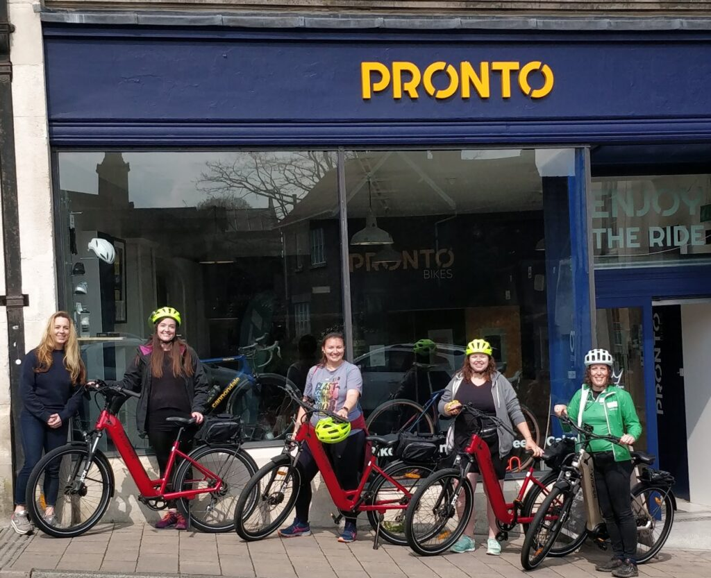 Group of women with bikes outside Pronto in Frome