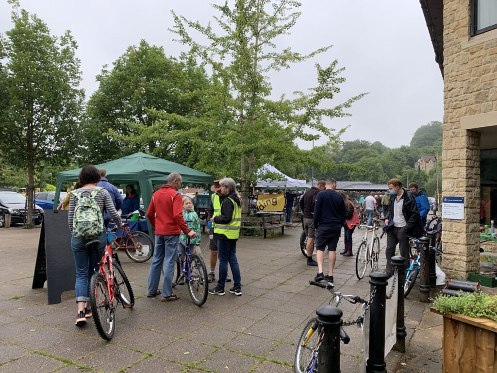 People and their bikes at the Bike Jumble