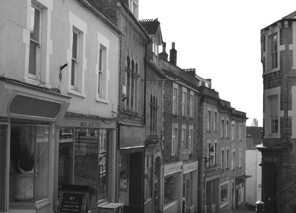 A black and white picture looking down at various shops from the top of Catherine Hill